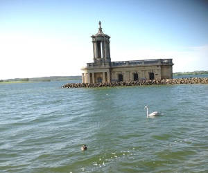 The church half submerged under Rutland Water.